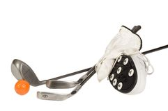 Golf clubs and a shoe. Group of golf accesories including clubs, shoes, with metal spikes, glove and ball stock photography