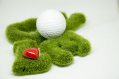 Golf con la lettera di amore su fondo bianco Immagine Stock