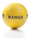 Golf concept. Single golf ball for use on the driving range (practice area). These balls are marked with a generic design and wording, so they could be easily Royalty Free Stock Image