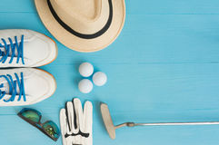 Golf concept : flat lay. Golf concept : panama hat, glove, golf balls, golf clubs, golf shoes, sunglasses on wooden table. Flat lay with copy space Stock Photos