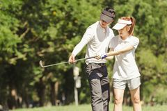 Golf Couple Stock Images