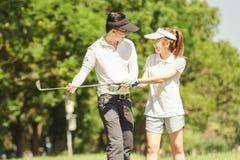 Golf Couple Stock Image