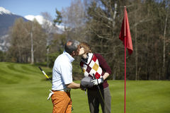 Golf couple kissing on a golf course Royalty Free Stock Images