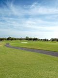 Golf Course. Golf cart path running through the course royalty free stock photo