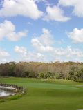 Golf Course. With a lake view Royalty Free Stock Photo