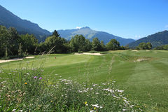 Golf Course. In front of a beautiful landscape scenery Royalty Free Stock Photos