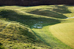 Golf-course. Part of golf-course as landscape with shadows Royalty Free Stock Images