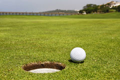 Golf Course. Close-up of a ball on a golf course Royalty Free Stock Photo