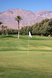 Golf course. In the mountain with exotic palm trees (Death Valley, California Royalty Free Stock Photo