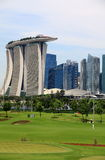 Golf course green lawn in Singapore. Singapore Marina bay golf course and Marina bay sands at background Royalty Free Stock Image