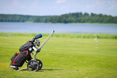 Golf course. Golf clubs in bag on a golf course field Stock Photos