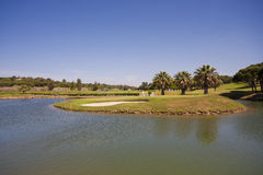 Golf Course. A nice view of a golf course with a lake and blue sky Stock Photos