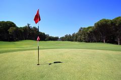 Golf course. Flag on the golf course Royalty Free Stock Image