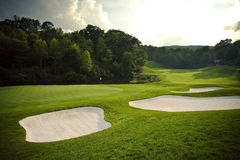 Golf Course. Horizontal photograph of a putting green and sand traps on a golf course Royalty Free Stock Photos