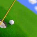 Golf course. Green and ball closeup Stock Image