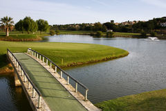 Golf Course. A golf course with a lake and a bridge Stock Images