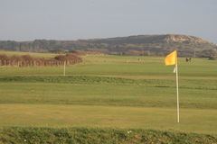Golf course. Gold course with yellow flag, Dorset England Stock Image