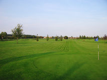 Golf course. Golfcourse with green and a flag royalty free stock image