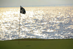 Golf course. Seaside golf course and flag Royalty Free Stock Photography