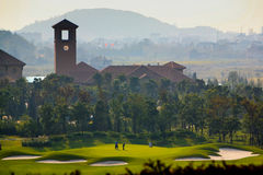 Golf course. And countryside tower Royalty Free Stock Photography
