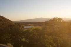 Golf Course from above. View from above of a golf course at sunset with side sunlight coming in Stock Photography