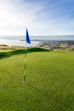 Golf course above beach with seaside view stock image