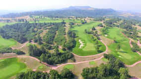 Golf course. Aerial view of golf course surrounded by natural park stock video