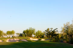Golf course in the Arizona desert. With mountains in the late afternoon sun Stock Photo