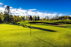 Golf Course in Autumn. The fall colors of autumn surround the greens of the golf course Stock Photography