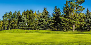 Golf Course in Autumn. The fall colors of autumn surround the greens of the golf course Stock Images