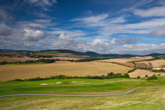 Golf course in autumn landscape. Detail of golf course in autumn landscape Royalty Free Stock Photo