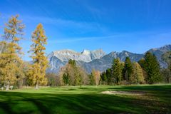 Golf course Heidiland, Bad Ragaz, Switzerland. Golf course with bunker and fairway in autumn with view to Alps, Bad Ragaz royalty free stock photography