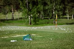 Golf course with balls. Horizontal outdoors shot of course for golf covered with the balls royalty free stock photos