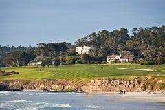 Golf course by the beach. Pebble Beach Golf Links is a golf course located in Pebble Beach, Carmel, California Stock Images