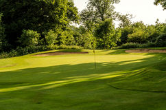 Golf course on a beautiful day, green grass, lush vegetation, go Royalty Free Stock Image