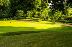 Golf course on a beautiful day, green grass, lush vegetation, go Royalty Free Stock Photo