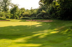 Golf course on a beautiful day, green grass, lush vegetation, go Royalty Free Stock Images