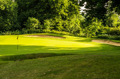 Golf course on a beautiful day, green grass, lush vegetation, go Royalty Free Stock Photography