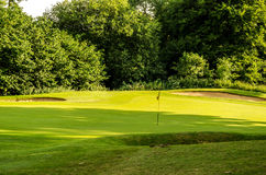 Golf course on a beautiful day, green grass, lush vegetation, go Stock Photography