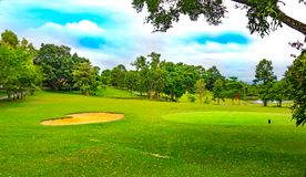Golf course is beautiful landscape on blue sky and cloud. And beautiful fairway and layout and green golf for golfer competition Stock Photo