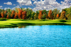 A golf course with a blue sky Royalty Free Stock Photos