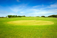 Golf course on Bornholm island with flag. Golf course on Bornholm island with white flag royalty free stock photography