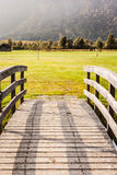 Golf course bridge. An old wooden bridge on an idyllic meadow or a beautiful golf course Stock Image