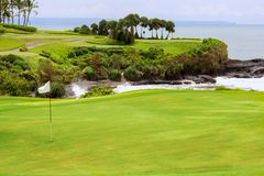 Golf course with bunker and flag, fields of island. Golf course with bunker and flag. Green fields of island Royalty Free Stock Image
