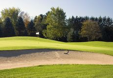 Golf Course Bunker Hazard. A very well designed golf courseand a great day to play golf in Wisconsin. The bunker hazard is close to the green stock photo