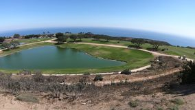 Golf course California. Golf course with palm trees of University, Malibu, United States. Aerial view of Pacific Coast in California. The campus on the hills stock video footage