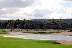 Golf course at Caribbean island with ocean in the back stock photos
