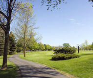 Golf Course Cart Path. The golf cart path is directly next to the tee boxes and fairways a scenic ride. Wisconsin golf Royalty Free Stock Photo