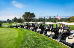 Golf course. With carts and blue sky stock photos