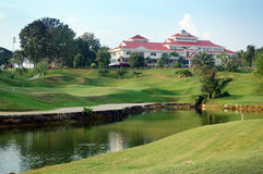 Golf course and club house. A beautiful scenery of golf course and club house stock photography